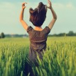 Happy woman jumping in the green field — Stock Photo #54914685