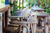 Old wooden chair in front of bar — Stock Photo
