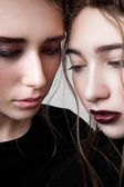 Closeup portrait of two fashion models with pigtails — Stock Photo