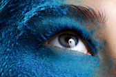Closeup eye with blue makeup — Stock Photo