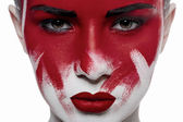 Girl with red lips and blood on face — Stock Photo