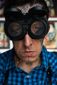 Portrait of tattoo master in welder glasses — Stock Photo