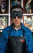 Tattooed man in welder glasses and shirt — Stock Photo