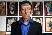 Man with tattooes on face in black jacket and shirt — Stock Photo