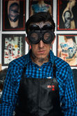 Smiling tattoo artist in welder glasses in studio — Stock Photo