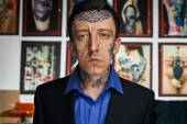 Portrait of tattoo master in black jacked and shirt — Stock Photo