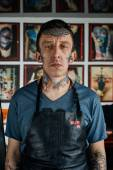 Tattooed man in leather apron — Stock Photo