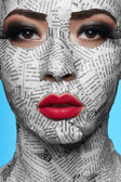 Beauty Model with Newspaper on Face — Stock Photo