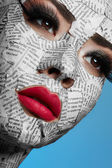 Model with Newspaper on Face — Stock Photo