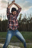 Lumberjack with Beard, Hat and Shirt swings the ax — Stock Photo