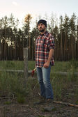 Portrait of bearded Lumberjack with Hat, Boots, Shirt and Ax — Stock Photo