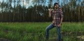 Serious Lumberjack in a Forest — Stock Photo
