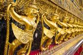 Gold ornamental pattern statuettes. — Stock Photo