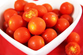 Cherry tomatoes close up. Vibrant red. — Stock Photo