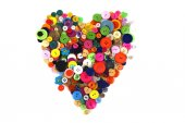 Heart shape made of haberdashery buttons — Stock Photo