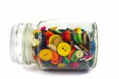Colourful haberdashery buttons in a glass jar — Stock Photo
