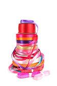 Colorful stack of haberdashery ribbons — Stock Photo