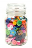 Colorful Haberdashery buttons in a glass jar. Vertical on White  — Stock Photo