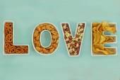 Love snacks in Love letter bowls — Stock Photo