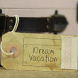 Dream vacation tag on vintage suitcase — Stock Photo #63447871