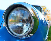 Old chromium-plated headlight — Stock Photo