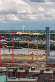 Construction cranes and wind turbines in Hamburg — Stok fotoğraf