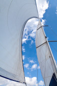 Sails filled with wind against the sky with clouds. — Stock Photo