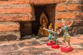 Toy Angel Doll Buddha Status at Wat Yai Chaimongkol, Ayutthaya,  — Stock Photo