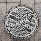 Close-up of the metal manhole cover in thailand — Stock Photo