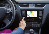 Woman using navigation system while driving a car — Foto de Stock