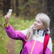 Woman making selfie photo while hiking in forest — Stock Photo #57840521