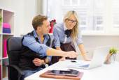 Young man and female colleagues working together in the office — Stock Photo
