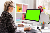 Designer using graphics tablet while working with computer — Stockfoto