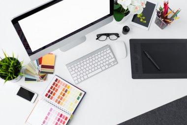 Creative professional designer's desk from above