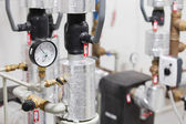 Manometer and heating pipelines — Stock Photo