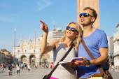 Couple reading tourist guide — Stock Photo