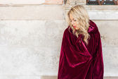 Mysterious woman in red cloak — Stock Photo