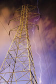 Electricity Pylon with Lightning in Background. — Stock Photo