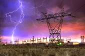 Power Distribution Station with Lightning Strike. — Stock Photo