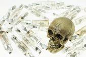 Skull and use lamp — Stock Photo