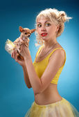 Girl with a small dog in hand — Stock Photo