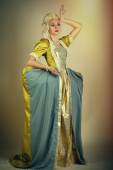 Picture of beautiful haughty queen in royal dress — Stock Photo