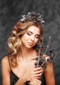 Winter Girl in Luxury fantasy in a wreath of cones on a blue background. — Stockfoto