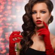 Glamour girl in red gloves holding a glass of champagne. drinking champagne. Beauty woman with perfect fashion makeup — Стоковое фото #64370903