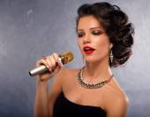 Singing Woman with Microphone.Glamour Singer Girl Portrait. Karaoke Song — Stock Photo