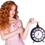 Beautiful woman holding a large clock. — Stock Photo #65522369