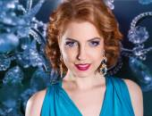 Beauty portrait of a redhead girl in blue dress.Beauty Woman with Perfect Makeup and luxury accessories — Stock Photo