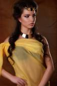 Beautiful egyptian woman bronze portrait.beauty portrait of a girl in the image of Egyptian — Stock Photo