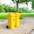 Trash can yellow in park — Stock Photo #57785681