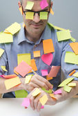 Busy white collar covered with stick notes — Stock Photo
